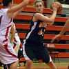 Norman High forward Taylor Ely tries to keep the ball away from the Durant defense Wednesday during the Tigers' loss at the Del City Holiday Basketball Tournament.<br /> Transcript Photo by Kyle Phillips