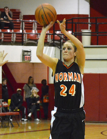 Norman High forward Beth Cox takes a shot  Wednesday during the Tigers' loss to Durant at the Del City Holiday Basketball Tournament.<br /> Transcript Photo by Kyle Phillips