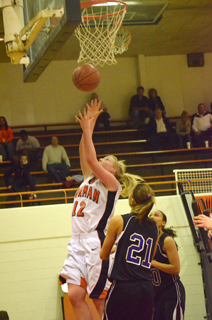Norman High's Albany Anderson goes up for a shot Friday night during the Tigers' game against Moore High School.<br /> Transcript Photo by Kyle Phillips