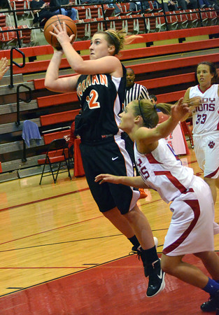 Norman High forward Taylor Ely takes a shot Wednesday during the Tigers' loss to Durant at the Del City Holiday Basketball Tournament.<br /> Transcript Photo by Kyle Phillips