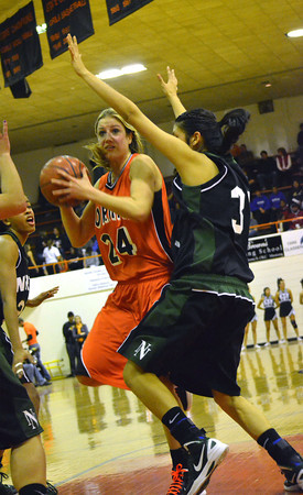 Norman High's Bethany Cox tries to get around a Norman North defender Friday night during the Clash basketball game at NHS.<br /> Transcript Photo by Kyle Phillips