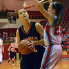 Norman High forward Beth Cox takes a shot  Thursday during the Tigers' game at the Del City Holiday Basketball Tournament.<br /> Transcript Photo by Kyle Phillips