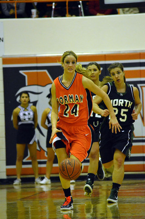 Norman High's Bethany Cox dribbles the ball down the court Friday night during the Tigers' game against Norman North.<br /> Transcript Photo by Kyle Phillips