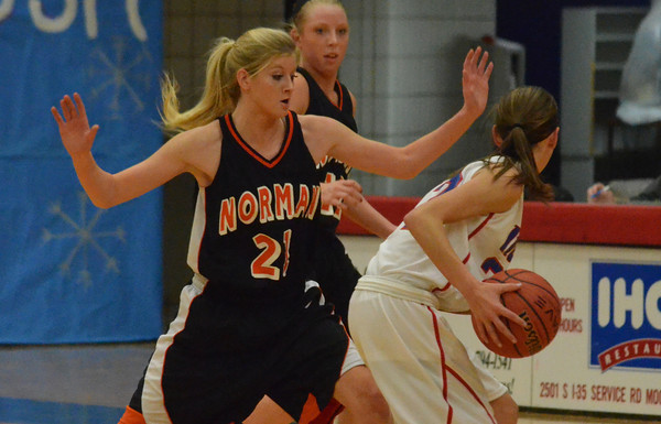 Norman High's Taylor Ely (23) guards a Moore High player  Friday during the Tigers' game against the Lions.<br /> Kyle Phillips/The Transcript