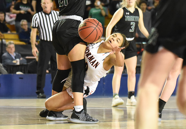 Norman high's Kelbie Washington takes a foul  during the Tigers' game against Norman North, Saturday, March 9, 2019, at ral Roberts University. (Kyle Phillips / The Transcript)