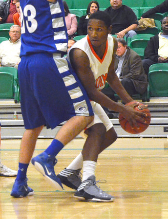 Norman High's Tre'Vez Stevenson looks for an open teammate to pass the ball to during the Tigers' game against Guthrie Thursday during the McGuinness Classic.<br /> Kyle Phillips/The Transcript
