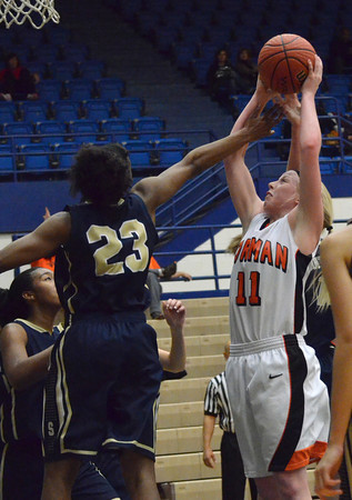 Norman High's Albany Anderson grabs a rebound over Southmoore's Serithia Hawkins during the Tigers' game against the Sabercats at the Regional Basketball Tournalment at Choctaw High School.<br /> Kyle Phillips/The Transcript