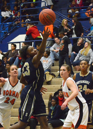 Southmoore's Serinthia Hawkins throws up a shot  during the Sabercat's game against Norman High at the Regional Basketball Tournalment at Choctaw High School.<br /> Kyle Phillips/The Transcript