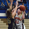 Norman High's Albany Anderson shoots the ball over Southmoore's Kyra Gilbert during the Tigers' game against the Sabercats at the Regional Basketball Tournalment at Choctaw High School.<br /> Kyle Phillips/The Transcript