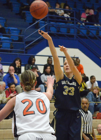 Southmoore's Bailey Olsen shoots the ball during the Sabercat's game against Norman High at the Regional Basketball Tournalment at Choctaw High School.<br /> Kyle Phillips/The Transcript