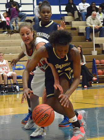 Norman High's Bethany Cox tries to get to the ball before Shouthmoore's Serithia Hawkins during  at the Regional Basketball Tournalment at Choctaw High School.<br /> Kyle Phillips/The Transcript
