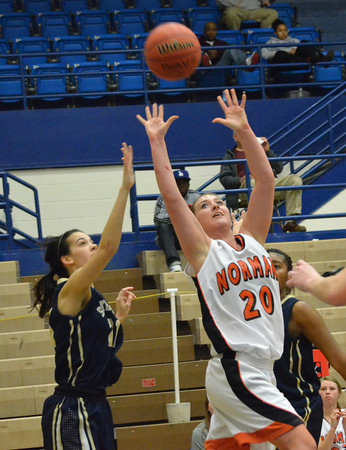 Norman High's Taylor Ely takes a wild shot Thursday during the Tigers' game against Soutmoore at the Regional Basketball Tournalment at Choctaw High School.<br /> Kyle Phillips/The Transcript