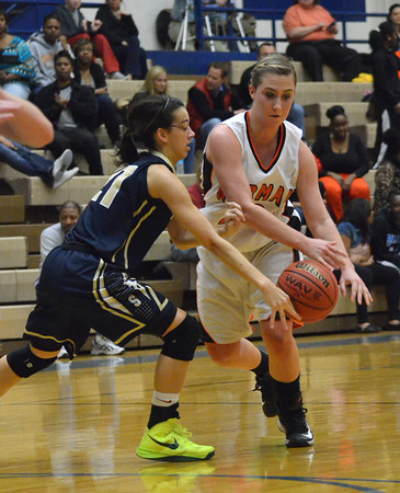 Southmoore's Kyra Gilbert gets the ball away from Norman High's Tayor Ely during the Tigers' game against the Sabercats at the Regional Basketball Tournalment at Choctaw High School.<br /> Kyle Phillips/The Transcript