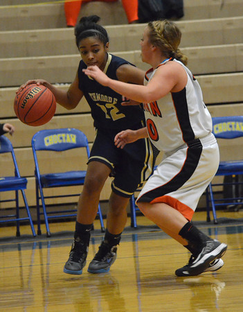 Southmoore's Cyndi Campbell pushes past Norman High's Chandler Coale  during the Sabercat's game against Norman High at the Regional Basketball Tournalment at Choctaw High School.<br /> Kyle Phillips/The Transcript
