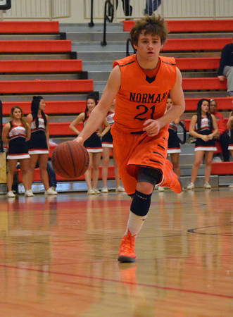 Norman High's John Bernardello drives down the court Tuesday during the Tigers' game against Westmoore.<br /> Kyle Phillips/The Transcript