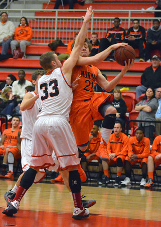 Westmoore's Tripp Fuller (33) stops Norman High's John Bernardello (21) from making a shot during the Tigers' game against the Jaguars Tuesday at Westmoore High.<br /> Kyle Phillips/The Transcript
