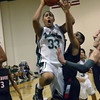 Norman North's Payton Prince take a jump shot over a Westmoore player Tuesday during the Timberwolves' loss to the Jaguars at Norman NOrth.<br /> Transcript Photo by Kyle Phillips