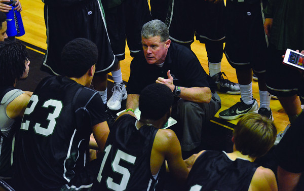 Norman North coach Butch Roberts talks to his team during a timeout in North's opening-round playoff loss to Midwest City on Friday, Feb. 24.