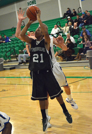 Norman North guard Aaron Goff takes a shot Thursday during the Timberwolves; game against Deer Creek at the Bishop McGuinness basketball Tournament.<br /> Transcript Photo by Kyle Phillips