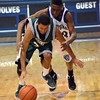 Norman North guard Aaron Goff tries to get to a loose ball before Southeast guard Romello Roberson during the Timberwolves' loss to the Spartans Friday at the Shawnee Invitational.<br /> Transcript Photo by Kyle Phillips