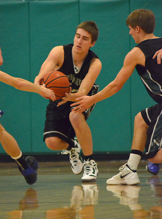 Norman North forward Logan Miller tries to keep his hands on the ball Thursday during the Timberwolves; game against Deer Creek at the Bishop McGuinness basketball Tournament.<br /> Transcript Photo by Kyle Phillips