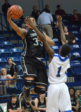 Norman North forward Payton Prince tries to get a shot over Supulpa's DeShawn Zachary during the Timberwolves' loss to the Chieftains Thursday during the Shawnee Invitational basketball tournament.<br /> Transcript Photo by Kyle Phillips