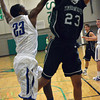 Norman North forward Joshau Santos gets stuffed by Deer Creek 's Ben Woodson Thursday during the Timberwolves; game against Deer Creek at the Bishop McGuinness basketball Tournament.<br /> Transcript Photo by Kyle Phillips