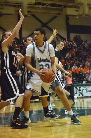 Norman North forward Joshau Santos tries to find room to take a shot during the Timberwolves' game against Norman High Friday night.<br /> Transcript Photo by Kyle Phillips