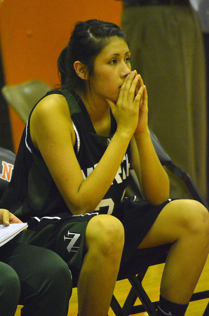 Norman North's Andrea Marris holds her breath as the Tigers' take their final shot that won them the game against the Tinmerwolves' Friday night during the Clash basketball game at NHS.<br /> Transcript Photo by Kyle Phillips
