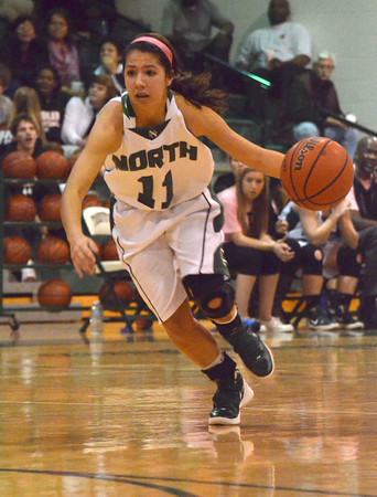Norman North guard Bri Kuestersteffen dribbles the ball down the court as she rushes toward the basket during the Clash basketball game Friday night at Norman North.<br /> Transcript Photo by Kyle Phillips