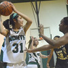 Norman North's Andrea Marris looks for an open teammate during the Timberwolves' game against Midwest City Tuesday at Norman NOrth.<br /> Transcript Photo by Kyle Phillips