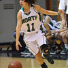 Norman North guard Hayley Scott dribbles the ball down the court as the Timberwolves take on Harrah Friday night during the Southern Nazarene basketball tournament.  The Timberwolves ???  Harrah  - in the semi-final game.<br /> Transcript Photo by Kyle Phillips