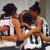 The Norman North Girl's basketball team huddles up during a timeout from their game againsat Midwest City.<br /> Transcript Photo by Kyle Phillips