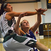 Norman North's Bri Kuestersteffen tries to block a Moore High School player from making a shot Tuesday night during the Timberwolves' game against the Lions at Norman North.<br /> Transcript Photo by Kyle Phillips