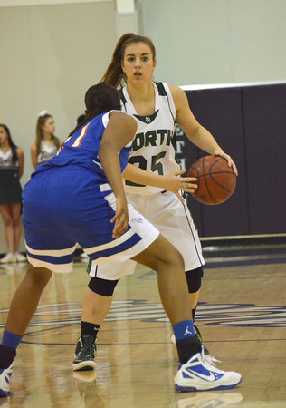 Norman North's Tori Thomas looks for a teammate to pass the ball to during the Timberwolves; game against Millwood Saturday night.<br /> Transcript Photo by kyle Phillips