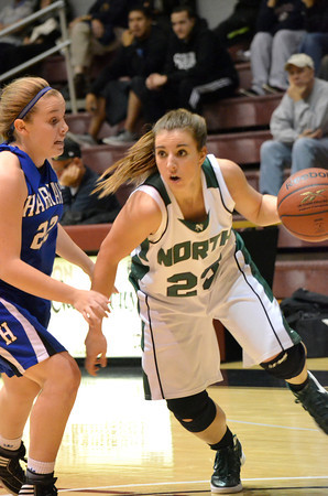 Norman North guard Tori Thomas drives the ball down the court as the Timberwolves take on Harrah Friday night during the Southern Nazarene basketball tournament.  The Timberwolves ???  Harrah  - in the semi-final game.<br /> Transcript Photo by Kyle Phillips