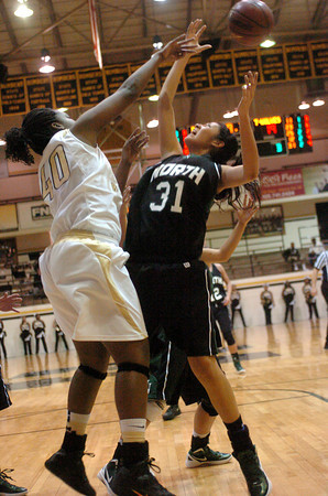Norman North's Ann Marris (31) fights Midwest City's Markita Zeigler (40) for a rebound Friday during the Timberwolves' loss to the Bombers in Midwest City.<br /> Transcript Photo by Kyle Phillips