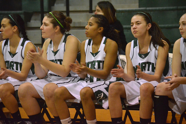 Players cheer on their team from the bench during Norman North's game against Midwest City.<br /> Transcript Photo by Kyle Phillips