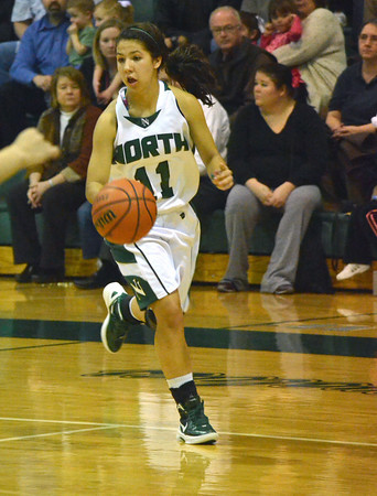 Norman North's Bri Kuestersteffen dribbles the ball down the court during the Timberwolves' game against Midwest City Tuesday night at Norman North.<br /> Transcript Photo by Kyle Phillips