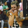 Norman North's Tori Thomas reacts as she is led off the court  after the Timberwolves' loss to Norman High Friday night during the Clash basketball game at Norman North.<br /> Transcript Photo by Kyle Phillips