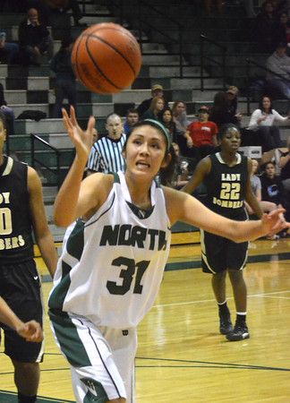 Norman North's Andrea Marris tries to grab a loose ball during the Timberwolves' game against Midwest City Tuesday at Norman NOrth.<br /> Transcript Photo by Kyle Phillips