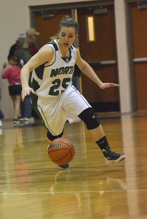 Norman North's Tori Thomas losses control of the ball as she dribbles down the court Tuesday during the Timberwolves' game against the Bombers at Norman North.<br /> Transcript Photo by Kyle Phillips