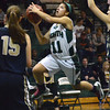Norman North's 	Bri Kuestersteffen takes a shot during the Timberwolves' game against Southmoore Tuesday at Norman North.<br /> Kyle Phillips/The Transcript