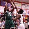 "6'7"" junior forward shoots over a Putnam City West defender for Norman North at Putnam City High School Friday, Feb. 22."