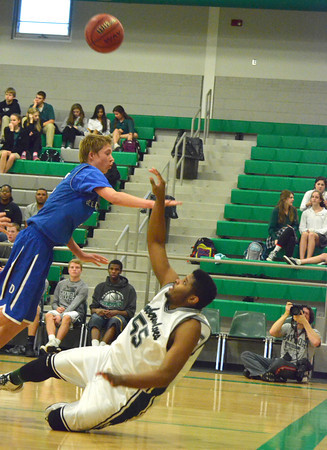 Norman North's Kairo Rutledge (55) takes a shot as he is knocked down during the Timberwolves' game against Deer Creek Thursday during the McGuiness Classic.<br /> Kyle Phillips/The Transcript
