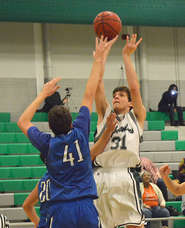 Norman North's Tye Neubauer (31) take a shot at the goal during the Timberwolves' game against Deer Creek Thursday during the McGuiness Classic.<br /> Kyle Phillips/The Transcript