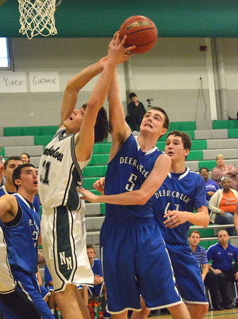 Norman North's Tye Neubauer grabs a rebound during the Timberwolves' game against Deer Creek Thursday during the McGuiness Classic.<br /> Kyle Phillips/The Transcript