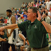 Norman North basketball coach Butch Roberts gives his players directions during the Timberwolves' game against Edmond North Friday at the McGuinness Classic.<br /> Kyle Phillips/The Transcript
