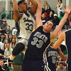 Norman North's Payton Prince (33) takes a shot over Edmond North's Austin Usery (33) Friday as the Timberwolves take on the Huskies during the McGuinness Classic.<br /> Kyle Phillips/The Transcript