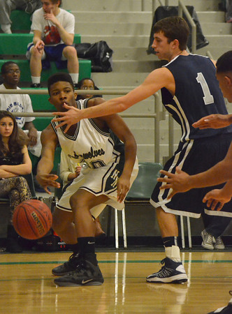 Norman North's Najji Brown passes the ball during the Timberwolves' game against Edmond North Friday during the McGuinness Classic.<br /> Kyle Phillips/The Transcript